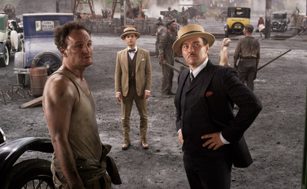 Jason Clarke as George Wilson, Tobey Maguire as Nick Carraway and Joel Edgerton as Tom Buchanan