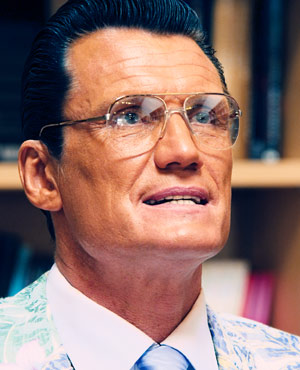 Dr. Sage Mennox played by Dolph Lundgren in Small Apartments