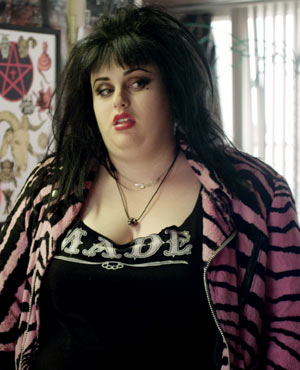 Rocky played by Rebel Wilson in Small Apartments