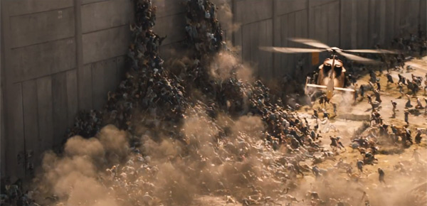 Zombies attempt to climb over a wall in World War Z