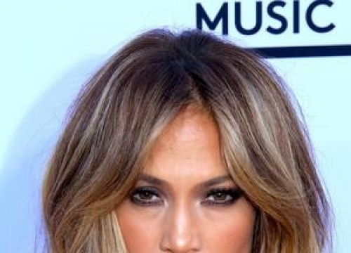 Jennifer Lopez Gets Covered With Confetti At Los Angeles Airport