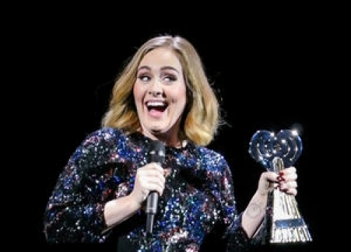 Adele Accidentally Kisses Fan Onstage