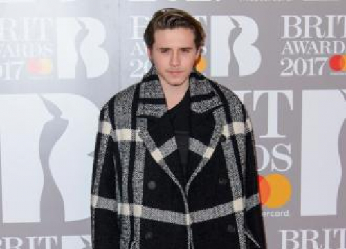 Brooklyn Beckham Delays Book Release