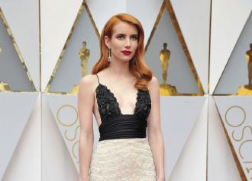 Emma Roberts Almost Rips Isabelle Huppert's Dress At The 89th Academy Awards