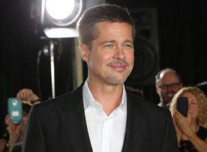Brad Pitt Steps Out For Public Charity Show With Sting And Others
