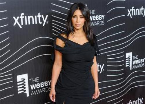 Kim Kardashian West Will 'Tone Down' Nude Shoots