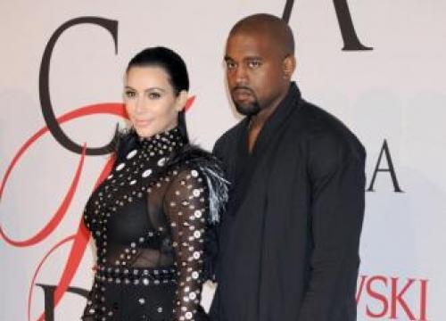 Kim Kardashian West Raids Husband Kanye's Wardrobe