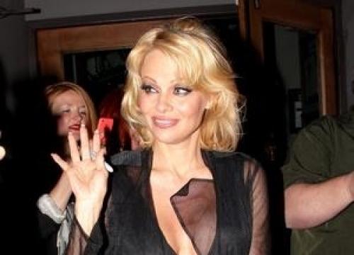 Pamela Anderson Strips For Peta's Psycho Ad