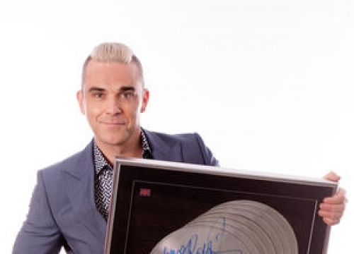 Robbie Williams To Auction Belongings For Children's Charity