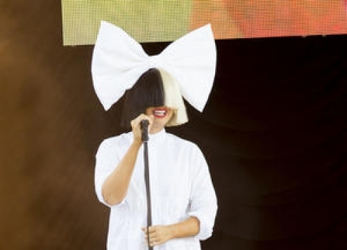 Sia Shows Her Face On Sesame Street