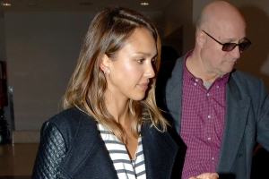 Jessica Alba Boards A Plane At LAX