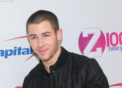 Nick Jonas Charmingly Evades Lily Collins Romance Questions