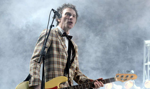 Tommy Stinson of The Replacements performs onstage during day 1 of the 2014 Coachella Valley Music & Arts Festival