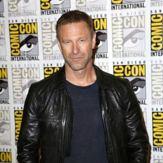 Aaron Eckhart urges Miles Teller to 'do well'