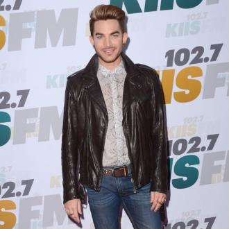 Adam Lambert flattered by Robbie Williams' admiration