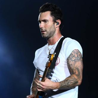 Maroon 5's Adam Levine delivers energetic Super Bowl halftime show