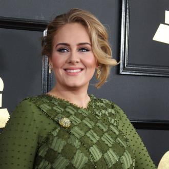 Adele snaps Grammy