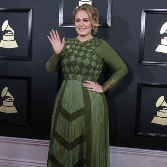 Adele having 'difficultly' writing fourth record because she's so happy