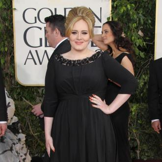Adele Shows Up At Golden Globes For 'A Night Out'