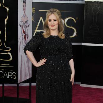Adele celebrates Oscars win with burger