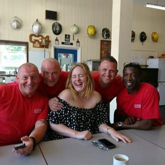 Adele visits firefighters who rescued Grenfell Tower residents
