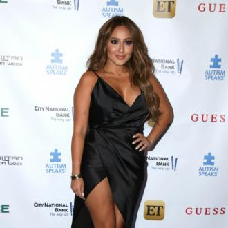 Adrienne Bailon designed her own wedding dress