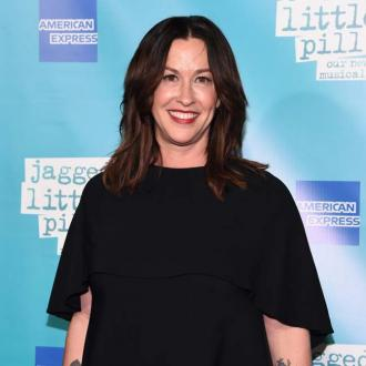 Alanis Morissette is glad her husband can play 'unconventional' roles in their marriage