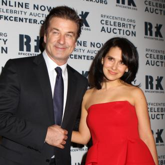 Alec Baldwin Reads Pregnancy Guide With Wife