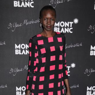 Alek Wek Wants To Show That 'Clothes Don't Wear Her'