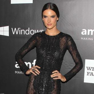 Alessandra Ambrosio snacks on junk food