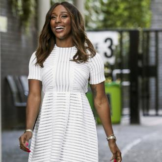 Alexandra Burke feels late mother's presence when she sings