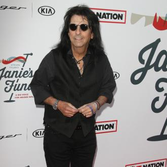 Alice Cooper quit booze after seeing his friends pass away