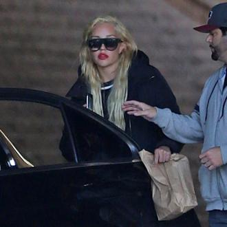 Amanda Bynes is 'getting along' with her parents