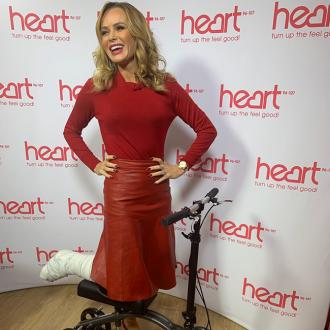 Amanda Holden returns to work on scooter after leg injury