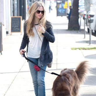 Amanda Seyfried Flies With Dog