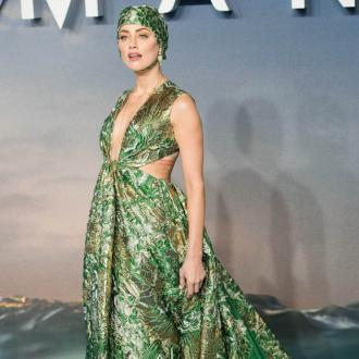 Amber Heard wore a swimming cap to the 'Aquaman' premiere