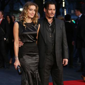 Johnny Depp and Amber Heard are 'doing great'