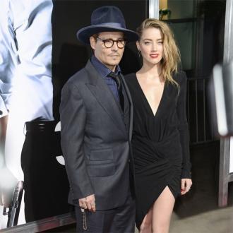 Amber Heard 'Unhappy' With Johnny Depp