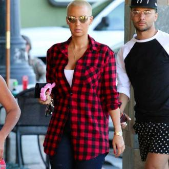 Amber Rose And Wiz Khalifa 'Are Working On Their Friendship'
