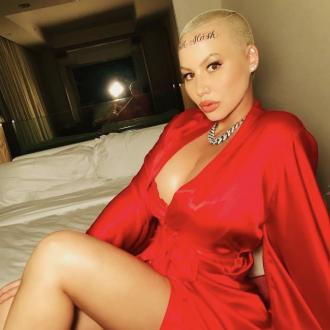 Amber Rose debuts forehead tattoos in honour of her sons