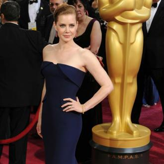 Amy Adams likes to feel 'womanly' on red-carpets