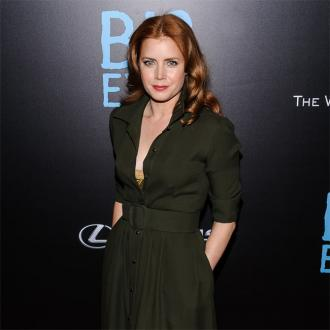 Amy Adams collects wooden birds