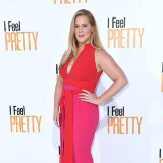Amy Schumer 'staying positive' in IVF struggle