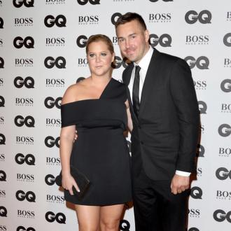 Amy Schumer's ex Ben Hanisch says she will be a 'great mother'