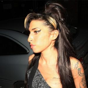 Amy Winehouse Dress Sells For 43,200