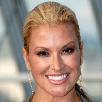 Anastacia loves 'bionic' breasts