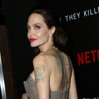 Angelina Jolie admits she fell into acting to pay her mother's bills
