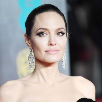 Angelina Jolie emotional as she drops son at South Korean college