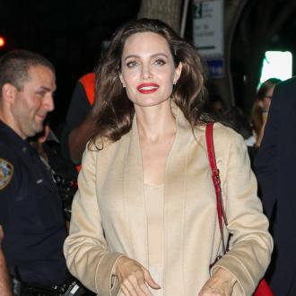 Angelina Jolie Comforted By 'Sweet' Maddox