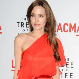 Angelina Jolie Travels At Christmas